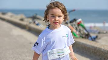 A young boy taking part in the 1k event during the Aramco Beach Run.